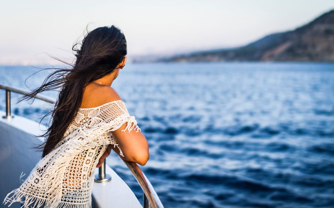woman-looking-out-to-sea-onboard-yacht-honest-marine-services